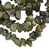 Bead, serpentine (natural), medium chip, Mohs hardness 2-1/2 to 6. Sold per 34-inch strand.