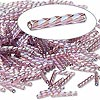 Bugle bead, Dyna-Mites™, glass, transparent rainbow light purple, 12mm twisted. Sold per 50-gram pkg.