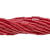 Bugle bead, Preciosa Czech glass, opaque ruby red, #3 with round hole. Sold per pkg of 1 hank.