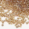 Seed bead, Delica®, glass, color-lined golden rose, (DBL901), #8 round. Sold per 50-gram pkg.