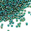 Seed bead, Dyna-Mites™, glass, silver-lined rainbow dark green, #11 round with square hole. Sold per 40-gram pkg.