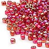 Seed bead, Dyna-Mites™, glass, silver-lined rainbow ruby red, #6 round with square hole. Sold per 1/2 kilogram pkg.