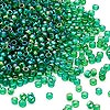 Seed bead, Dyna-Mites™, glass, transparent rainbow emerald green, #11 round. Sold per 1/2 kilogram pkg.