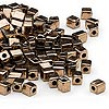 Seed bead, Miyuki, glass, opaque metallic dark gold, (SB457), 3.5-3.7mm square. Sold per 25-gram pkg.