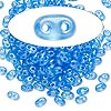 Seed bead, Preciosa Twin™, Czech glass, transparent sea blue terra pearl, 5x2.5mm oval with 2 holes. Sold per 10-gram pkg.