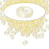 Seed bead, Preciosa Twin™, glass, transparent light yellow terra pearl, 5x2.5mm oval with 2 holes. Sold per 50-gram pkg.
