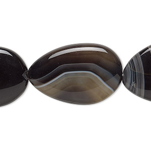 bead, black agate (dyed), 26x17mm-32x23mm freeform, b grade, mohs hardness 6-1/2 to 7. sold per 8-inch strand, approximately 5 beads.