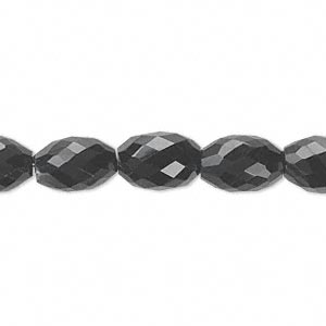 bead, black onyx (dyed), 11x8mm hand-cut faceted oval, b grade, mohs hardness 6-1/2 to 7. sold per pkg of 10.
