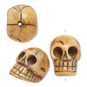 bead, bone (dyed), antiqued, 20x14mm hand-carved skull, mohs hardness 2-1/2. sold per pkg of 3.