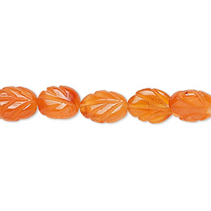 bead, carnelian (dyed / heated), 8x6mm-10x8mm carved leaf with 0.4-1.4mm hole, c grade, mohs hardness 6-1/2 to 7. sold per 16-inch strand.