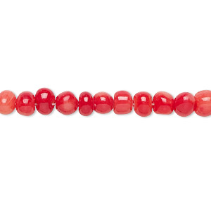 bead, coral (dyed), red, small hand-cut pebble, mohs hardness 3-1/2 to 4. sold per 16-inch strand.