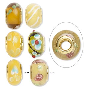 bead, dione, lampworked glass and gold-finished brass grommets, transparent yellow and opaque multicolored, 12x8mm-16x9mm rondelle with assorted designs, 4.5-5mm hole. sold per pkg of 6.