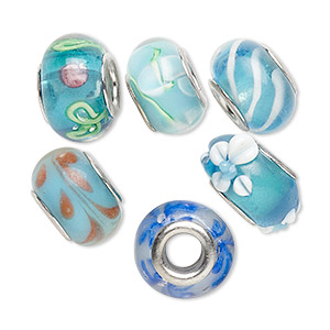 bead, dione, lampworked glass and imitation rhodium-plated brass grommets, transparent blue and opaque multicolored, 12x8mm-16x9mm rondelle with assorted designs, 4.5-5mm hole. sold per pkg of 6.