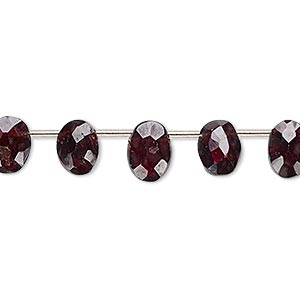bead, garnet (dyed), 8x6mm-9x7mm hand-cut top-drilled faceted flat oval, b- grade, mohs hardness 7 to 7-1/2. sold per pkg of 14 beads.