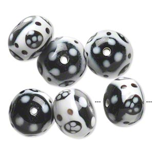 bead, lampworked glass, opaque white and black, 15x11mm-17x12mm rondelle with flower and dot design. sold per pkg of 6.