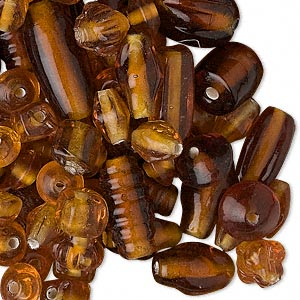 bead mix, glass, translucent amber color, 7x4mm-21x11mm mixed shapes. sold per pkg of 50 grams.