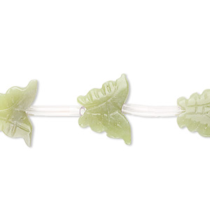 bead, olive new jade (natural), 14x11mm-16x12mm carved butterfly, d grade, mohs hardness 2-1/2 to 6. sold per pkg of 14 beads.