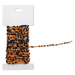beaded wire, glass and brass, opaque luster orange and black #9 and #6 round seed beads. sold per 15-foot card with hanging tab.