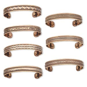 bracelet, cuff, copper, 11-12mm wide with assorted patterns, 7 to 7-1/2 inches with magnetic ends. sold per pkg of 7.
