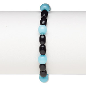 bracelet, stretch, glass and cats eye glass, opaque sky blue and black, 7-8mm round and 7x5mm-8x6mm barrel, 6-1/2 inches. sold individually.