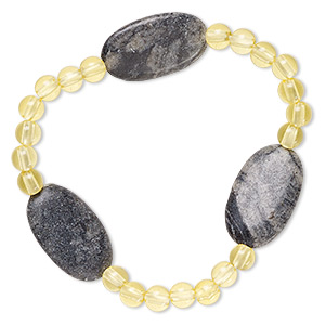 bracelet, stretch, picasso marble (natural) and acrylic, yellow, 5mm round and 24x14mm-25x15mm flat oval, 6-1/2 inches. sold individually.