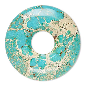focal, magnesite (dyed / stabilized), turquoise blue, 40mm hand-cut round donut, b grade, mohs hardness 3-1/2 to 4. sold individually.