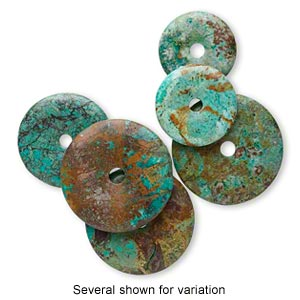 focal, turquoise (dyed / stabilized), blue and green, 35-60mm round donut, c grade, mohs hardness 5 to 6. sold individually.