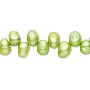 pearl, cultured freshwater (dyed), yellow-green, 6x5mm-8x6mm top-drilled rice, d grade, mohs hardness 2-1/2 to 4. sold per 15-inch strand.