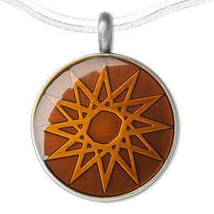 pendant, epoxy and pewter (zinc-based alloy), orange, 45x35mm single-sided matte round with star design. sold individually.