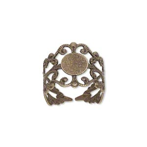 ring, antique brass, 16mm wide with filigree design and 8mm round flat pad setting, adjustable from size 7-9. sold per pkg of 8.