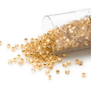seed bead, delica, glass, 24kt gold-lined crystal, (db33cut), #11 cut. sold per 4-gram pkg.