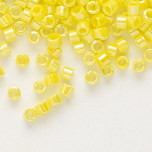 seed bead, delica, glass, opaque rainbow yellow, (db160), #11 round. sold per 7.5-gram pkg.