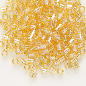 seed bead, delica, glass, transparent rainbow light topaz, (dbl100), #8 round. sold per 7.5-gram pkg.