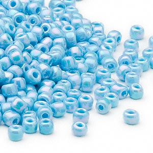 seed bead, dyna-mites™, glass, opaque rainbow light turquoise blue, #6 round. sold per 1/2 kilogram pkg.
