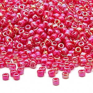 seed bead, dyna-mites™, glass, opaque rainbow red, #8 round. sold per 1/2 kilogram pkg.
