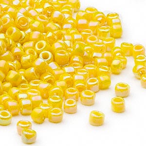 seed bead, dyna-mites™, glass, opaque rainbow yellow, #6 round. sold per 40-gram pkg.