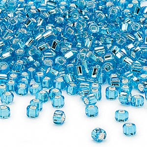 seed bead, dyna-mites™, glass, silver-lined translucent aqua, #6 round with square hole. sold per 40-gram pkg.