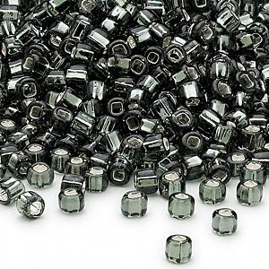 seed bead, dyna-mites™, glass, silver-lined translucent gunmetal, #6 round with square hole. sold per 1/2 kilogram pkg.