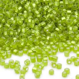 seed bead, dyna-mites™, glass, silver-lined translucent matte light green, #11 round with square hole. sold per 40-gram pkg.