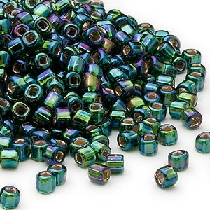seed bead, dyna-mites™, glass, silver-lined translucent rainbow dark green, #6 round with square hole. sold per 40-gram pkg.