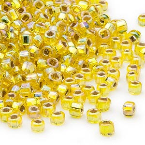 seed bead, dyna-mites™, glass, silver-lined translucent rainbow yellow, #6 round with square hole. sold per 40-gram pkg.
