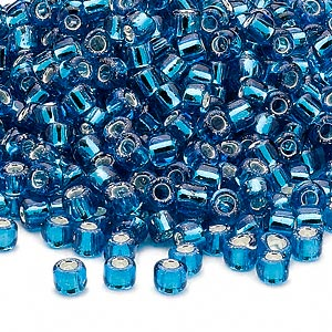 seed bead, dyna-mites™, glass, silver-lined translucent turquoise blue, #6 round. sold per 40-gram pkg.