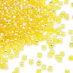 seed bead, dyna-mites™, glass, transparent rainbow yellow, #11 round. sold per 1/2 kilogram pkg.