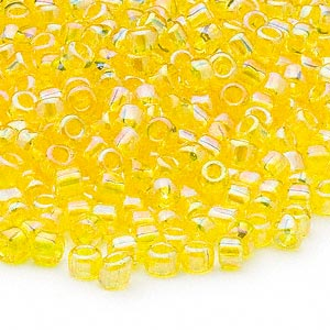 seed bead, dyna-mites™, glass, transparent rainbow yellow, #6 round. sold per 1/2 kilogram pkg.