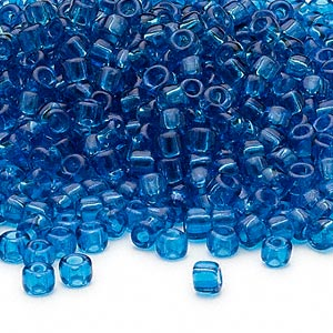 seed bead, dyna-mites™, glass, transparent turquoise blue, #6 round. sold per 1/2 kilogram pkg.