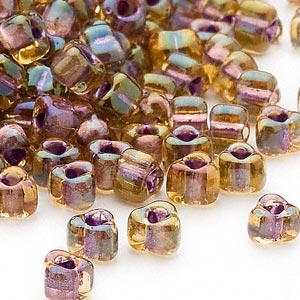 seed bead, miyuki, glass, transparent amber yellow color-lined lilac, (tr1167), #5 triangle. sold per 250-gram pkg.