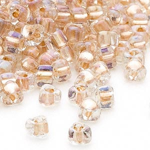seed bead, miyuki, glass, transparent clear color-lined bronze, (tr1133), #5 triangle. sold per 250-gram pkg.
