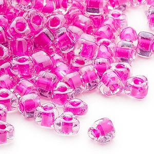 seed bead, miyuki, glass, transparent clear color-lined fuchsia, (tr1110), #5 triangle. sold per 25-gram pkg.