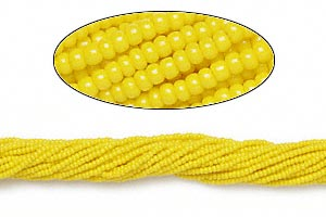 seed bead, preciosa, czech glass, opaque yellow, #11 round. sold per 1/2 kilogram pkg.