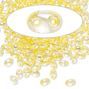 seed bead, preciosa twin™, czech glass, transparent yellow-lined clear terra, 5x2.5mm oval with 2 holes. sold per 10-gram pkg.